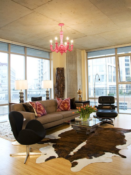 cozy-industrial-living-room-with-brown-sofa-colorful-plants-and-stunning-cowhide-rug